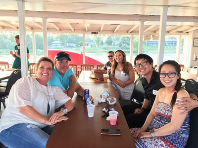 group of people on belle of louisville at alumni event