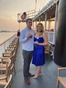 man and woman on belle of louisville at alumni event
